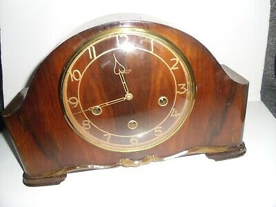 Vintage 1950s Smiths Enfield striking mantle clock with  key.