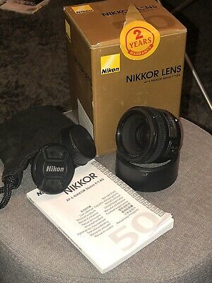 Nikon Nikkor AF-S 50mm F/1.8 G Lens with hood and nikon front and rear caps