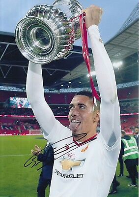 Manchester United Hand Signed Chris Smalling 12X8 Photo.