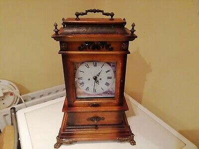 A Reproduction Mantle Clock With Ormolu Front Claw Feet, Mount's And Carrying...