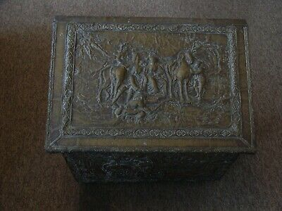 Old coal/log box with embossed brass decoration and hinged lid.
