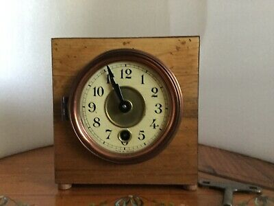salvaged and restored French clock movement ,placed in a new  case.Original face