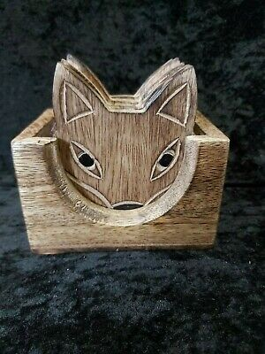 Set of 6 hand-carved wooden fox coasters in storage case