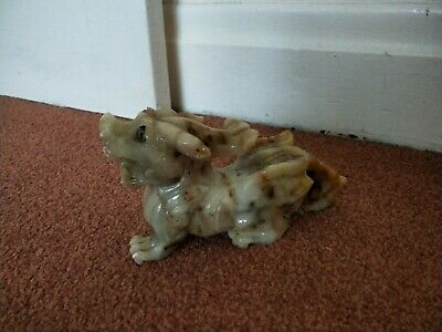 very old hand carved soapstone dog figure