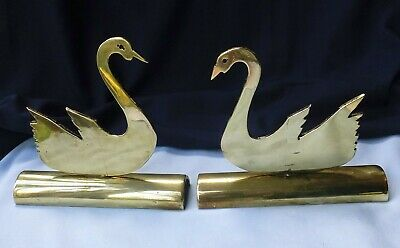 PAIR of ANTIQUE BRASS SWAN CHIMNEY ORNAMENTS with ELEGANT PROFILES