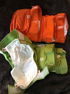 gdiapers medium Brand New. 3 orange/3 green. 6 diaper shells-no inserts include