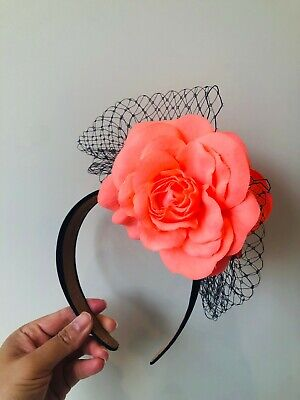 Coral flowered fascinator with blue navy netting on a headband!