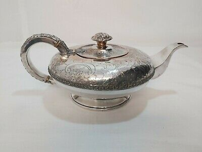 An Antique Victorian Silver Plated Tea Pot With Embossed Patterns.late 1800.s.