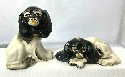 Pair of Porcelain King Charles Cavaliers Sitting and Laying down....