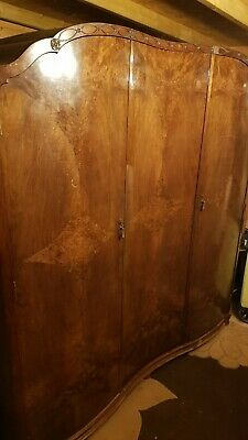 Antique? walnut effect triple wardrobe, Tudor rose carved top, curved shape fron