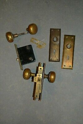Two Antique brass door knobs, door plates, keyhole plates two full sets Hardware
