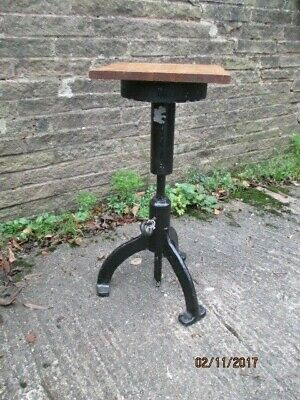 sculpture stand  -   cast iron wooden top