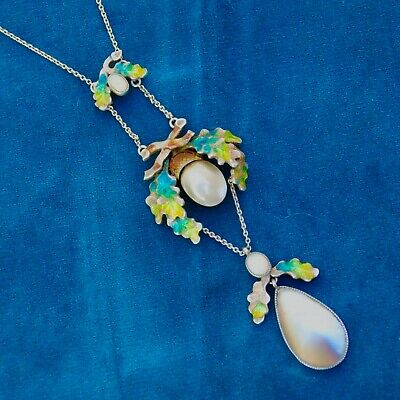 An antique arts and crafts opal pearl enamel silver necklace, oak leaves design