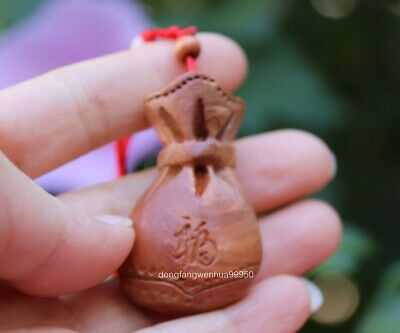 China Peach Wood Wooden Carved Feng Shui Wealth Coin Blessing Bag Amulet Pendant