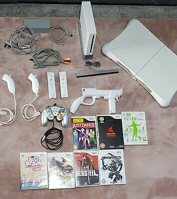 Nintendo Wii Bundle with Wii Fit Plus & Balance Board + Games