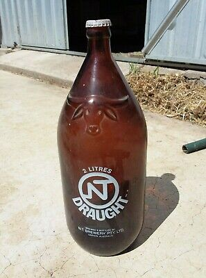 Empty two litre NT draught beer bottle with cap