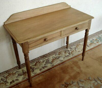 Blond hardwood writing table with twin drawers