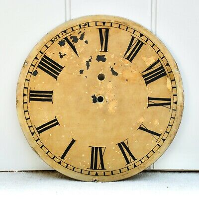 A vintage painted metal clock face, Roman numerals, ideal for conversion