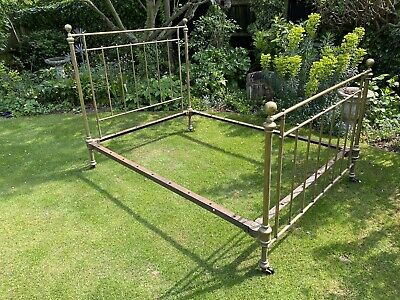 AN ANTIQUE BRASS AND IRON DOUBLE BED FRAME 6ft6 x 4ft6