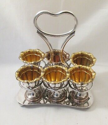 A Silver Plated Egg Stand / Cruet with 6 Gilded Egg Cups