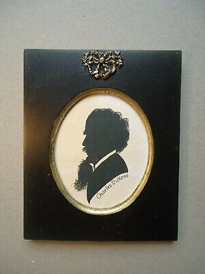 Painted silhouette  of  Charles Dickens  in  Victorian  style ribbon frame