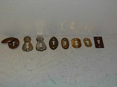8 antique brass key escutcheons.
