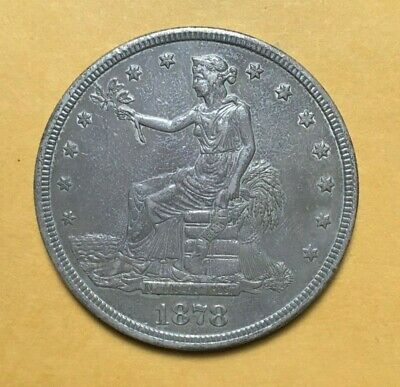 1878-S TRADE DOLLAR Very choice AU. Surfaces look Uncirculated.