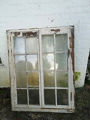 Victorian window and frame, central opening and 16 panes.