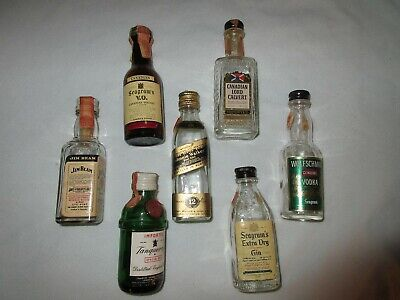 Seven I/10 Pt. Miniature glass booze bottles empty mostly early 70's