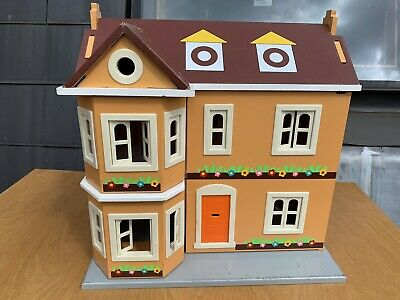 wooden dolls house with furniture