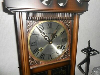 Antique Long-case pendulum Clock in wood and Brass.