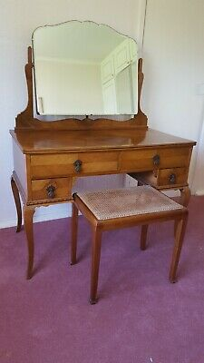 vintage wood dressing table with mirror and wicker topped stool