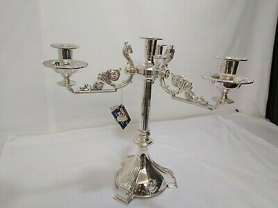A beautiful Large Silver Plated Candleabra With Rams Heads Decorated Patterns.
