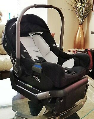 Nuna PIPA Infant Car Seat - Black w/ BaseInfant Insert and Store Away Canopy