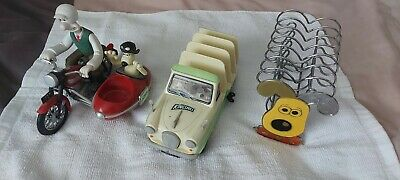 Wallace and grommet collection. Motorbike and sidecar.egg cups .metal toastrack.
