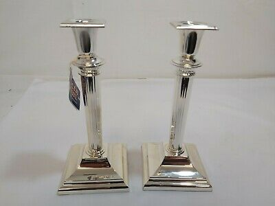 A Matching Pair Of Croanthian Style Silver Plated Candle Holders.very ornate.