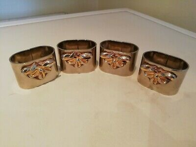 A Set Of 4 Silver Plate Napkin Rings
