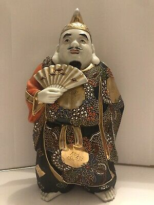 beautifully hand painted large vintage porcelain figure of a man holding a fan