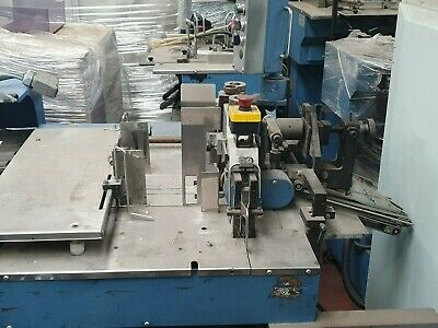 shuttle product booklet feeder Buhrs Poly Wrapper