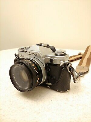 Canon AE-1 Program 35mm SLR Film Camera with 50mm F1.8 Canon FD Lens and Case
