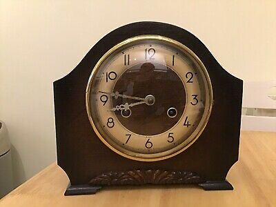 A Stunning Bentima Art Deco Oak Mantel Chiming Clock In Full Working Condition.