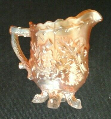 """carnival glass thistle & thorn legged jug (sowerby ?) marigold colour approx 4"""""""