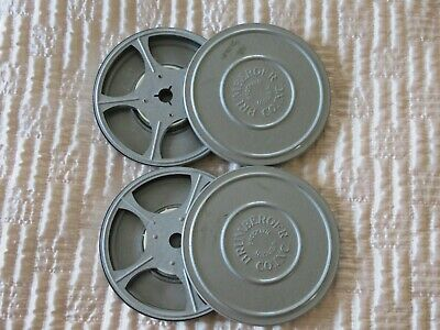 Two vintage 8mm film cannisters by Brumberger of Brooklyn, NY