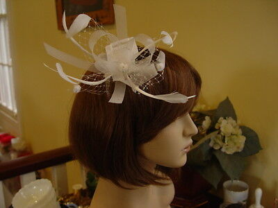 IVORY MESH ,HAIL SPOT NETTING and FEATHER FASCINATOR