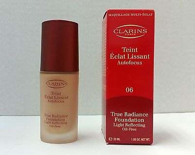 CLARINS TRUE RADIANCE FOUNDATION PRALINE 06 NEW IN BOX 1.06OZ/30ML