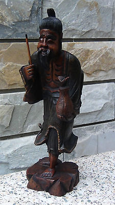 Antique 19C Chinese Camphor Wood Hand Carved Immortal Statue Holding A Basket