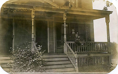 WOMAN & BOY WITH ANTIQUE DOLL OUTSIDE THE HOUSE - VINTAGE REAL PHOTO POSTCARD