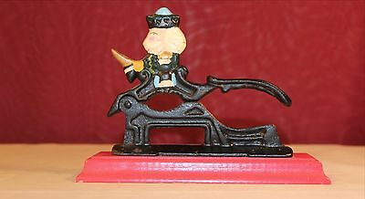 VINTAGE CAST IRON COLONIAL NUTCRACKER ON RED WOODEN BASE HAND PAINTED