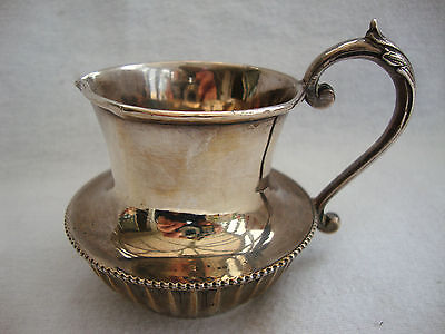 A QUALITY ANTIQUE SILVER PLATED A1 POTTER SHEFFIELD SMALL CREAMER JUG