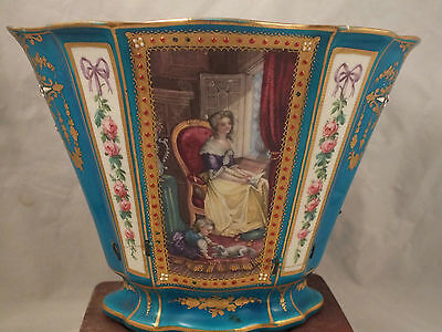 A  SEVRES PORCELAIN TOP HALF OF A CACHE-POT WITH PANELS ON A BLUE GROUND e19thC